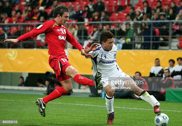 Fabian Barbiero of Adelaide United and Michihiro Yasuda of Gamba Osaka compete for the ball during FIFA Club World Cup Japan 2008 match between...