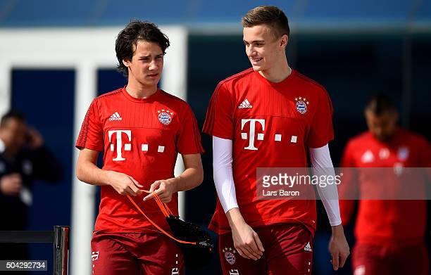 Fabian Benko and goalkeeper Christian Fruechtl are seen during a training session at day five of the Bayern Muenchen training camp at Aspire Academy...