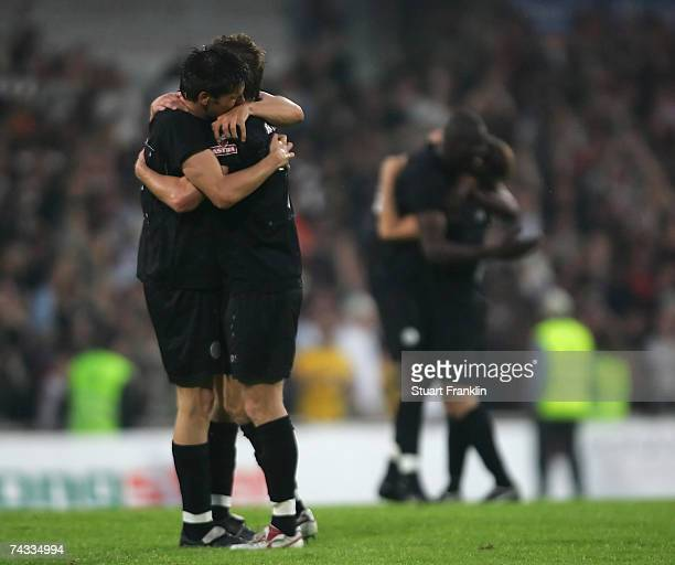 Fabian Boll and Marvin Braun of St. Pauli celebrates promotion to the second league after the Third League Northern Division match between FC...