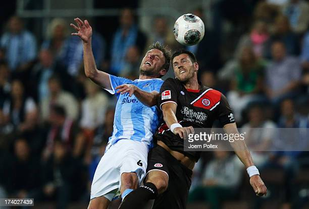 Fabian Boll of St. Pauli and Dominik Stahl of Muenchen compete for the ball during the Second Bundesliga match between FC St. Pauli and 1860 Muenchen...