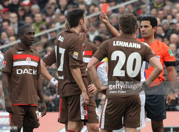 Fabian Boll of St Pauli and Martin Retov of Rostock get the red card from referee Babak Rafati during the Second Bundesliga match between FC St Pauli...