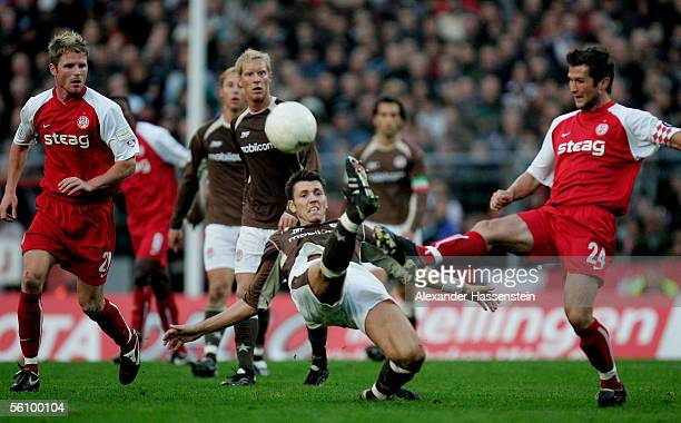 Fabian Boll of St Pauli challenges for the ball with Michael Bemben of Essen during the match of the Third Bundesliga between FC St Pauli and Rot...