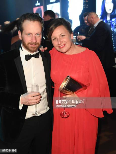 Fabian Busch and Sandra Scheucher pose at the Bambi Awards 2017 party at Atrium Tower on November 16 2017 in Berlin Germany