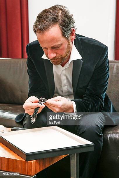 Fabian Busch hands over a JaegerLeCoultre watch for attending the Lola German Film Award 2016 at Sofitel on May 27 2016 in Berlin Germany