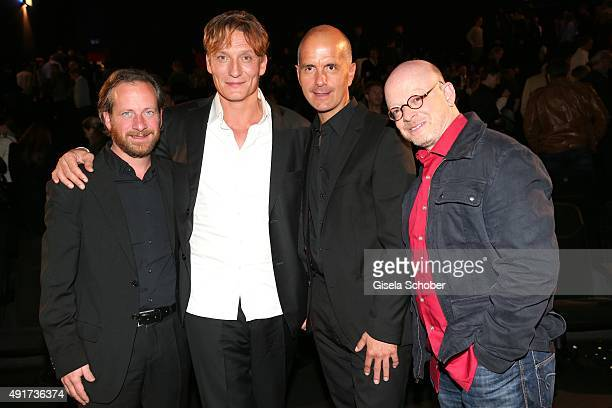 Fabian Busch, Oliver Masucci and Christoph Maria Herbst and Timur Vermes, writer of the book, during the special screening of the film 'Er ist wieder...