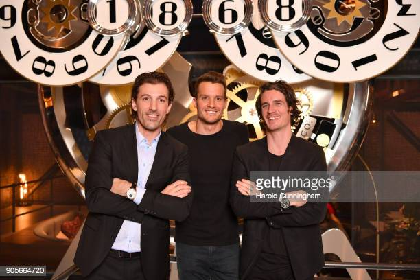 Fabian Cancellara Jan Frodeno and Patrick Seabase visit the IWC booth during the Maison's launch of its Jubilee Collection at the Salon International...