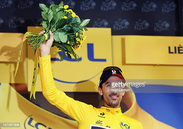 Fabian Cancellara of Switzerland and Radioshack-Nissan wears the race leader's yellow jersey after winning the Tour de France Prologue at Parc...