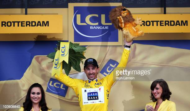 Fabian Cancellara of Switzerland and Team Saxo Bank pulls on the race leader's yellow jersey after winning the 8.9km Prologue for the 97th Tour de...