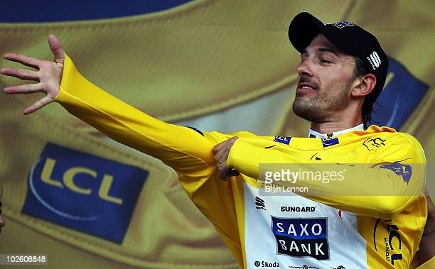 Fabian Cancellara of Switzerland and Team Saxo Bank pulls on the race leader's yellow jersey after winning the 89km Prologue for the 97th Tour de...