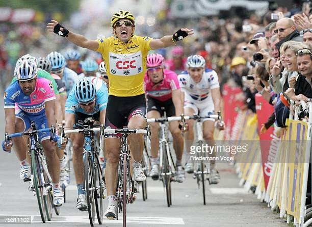 Fabian Cancellara of Switzerland and the CSC Team celebrates as he crosses the line to win the Stage Three of the Tour de France between Waregem and...