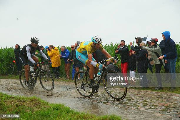 Fabian Cancellara of Switzerland and Trek Factory Racing Team and race leader Vincenzo Nibali of Italy and the Astana Pro Team in action on the pave...