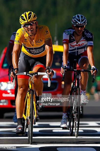 Fabian Cancellara of Switzerland riding for BMC Racing crosses the finish line in 20th place in stage seven of the 2012 Tour de France from Tomblaine...