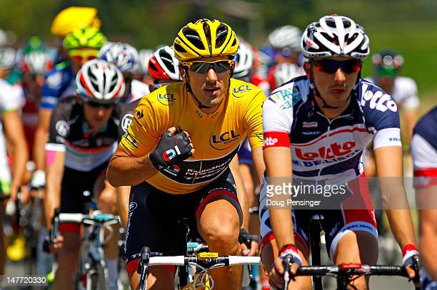 Fabian Cancellara of Switzerland riding for Radioshack-Nissan rides in the peloton as he defended the overall race leaders yellow jersey during stage...