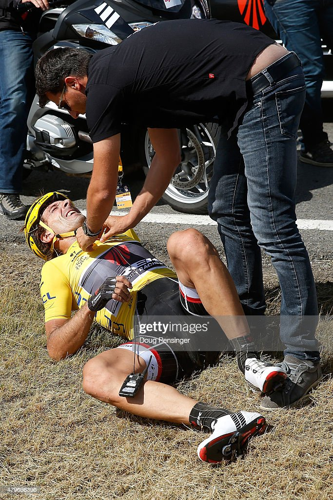 Fabian Cancellara of Switzerland riding for Trek Factory Racing in the overall race leader yellow jersey is attended to after being involved in a crash with 65km remaining in stage three of the 2015 Tour de France from Anvers to Huy on July 6, 2015 in Huy, Belgium.