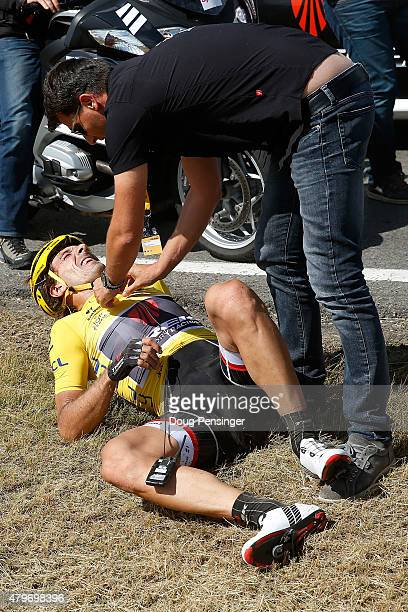 Fabian Cancellara of Switzerland riding for Trek Factory Racing in the overall race leader yellow jersey is attended to after being involved in a...
