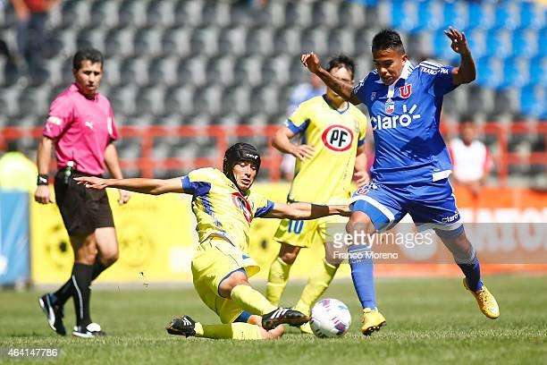 Fabian Carmona of U de Chile fights for the ball with Francisco Portillo of U de Concepcion during a match between U de Concepcion and U de Chile as...