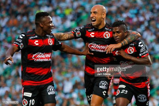 Fabian Castillo Ariel Nahuelpan and Miler Bolanos of Tijuana celebrate after scoring the first goal of their team during the 6th round match between...