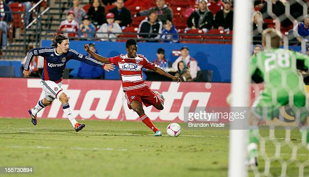Fabian Castillo of FC Dallas attempts a shot on goal as Ben Zemanski of Chivas USA and goal keeper Tim Melia defend during the second half of a...