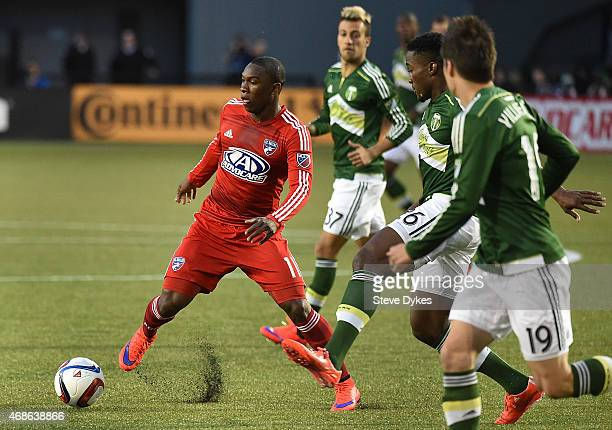 Fabian Castillo of FC Dallas brings the ball up the field on George Fochive of Portland Timbers during the first half of the game at Providence Park...