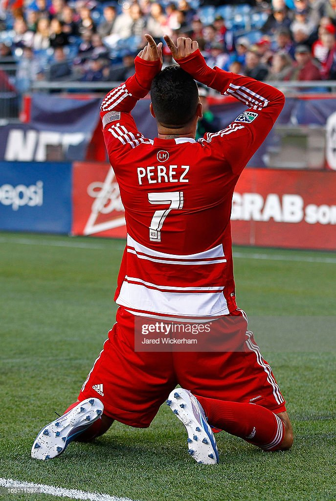 Fabian Castillo #7 of FC Dallas celebrates after scoring a goal late in the second half against the New England Revolution during the game at Gillette Stadium on March 30, 2013 in Foxboro, Massachusetts.