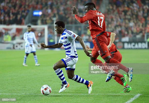 Fabian Castillo of FC Dallas dribbles the ball past Jozy Alitdore and Will Johnson of Toronto FC during the second half of an MLS soccer game at BMO...