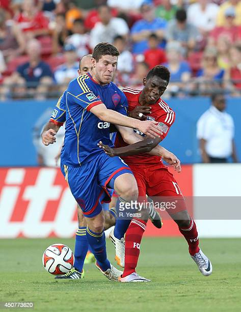 Fabian Castillo of FC Dallas fights with Dillon Powers of Colorado Rapids for control of the ball at Toyota Stadium on June 7 2014 in Frisco Texas