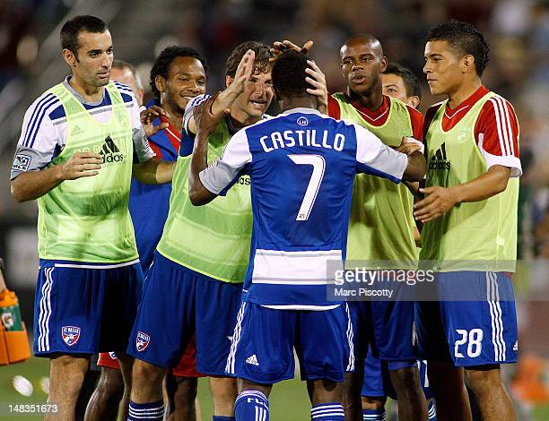 Fabian Castillo of FC Dallas gets congratulations from teammates on the bench after scoring the go ahead goal against the Colorado Rapids during...