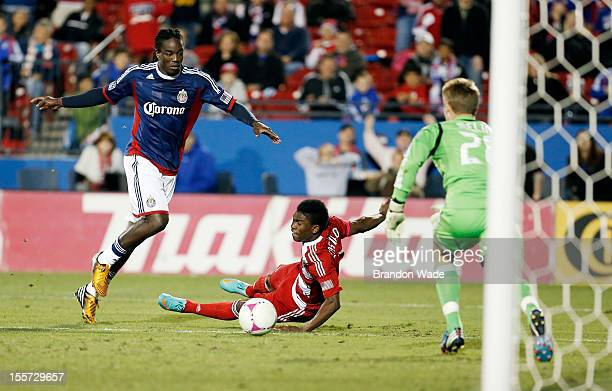 Fabian Castillo of FC Dallas is pushed off the ball as Shalrie Joseph of Chivas USA and goal keeper Tim Melia defend during the second half of a...