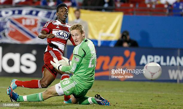 Fabian Castillo of FC Dallas shoots the ball past goal keeper Tim Melia of Chivas USA during the second half of a soccer game at Pizza Hut Park on...