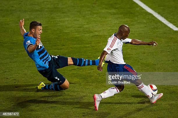 Fabian Castillo of MLS AllStars shoots past Kevin Wimmer of Tottenham Hotspur during the 2015 ATT Major League Soccer AllStar game at Dick's Sporting...
