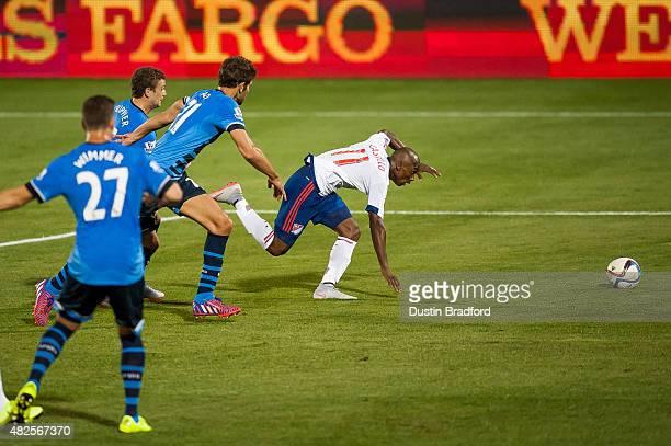 Fabian Castillo of MLS AllStars stumbles on the attack against the Tottenham Hotspur during the 2015 ATT Major League Soccer AllStar game at Dick's...