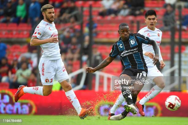 Fabian Castillo of Queretaro struggles for the ball with Miguel Barbieri of Tijuana during the 2nd round match between Queretaro and Tijuana as part...