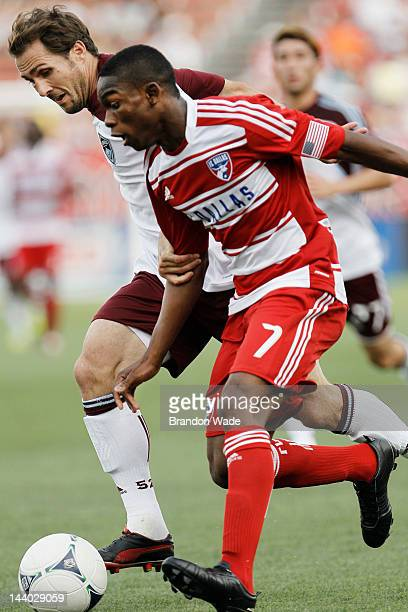 Fabian Castillo of the FC Dallas and Brian Mullan of the Colorado Rapids battle for position during the first half of a soccer game at FC Dallas...