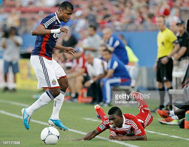 Fabian Castillo of the FC Dallas trips and slides out of bounds as Oswaldo Minda of the Chivas USA attempts to play the ball during the first half of...