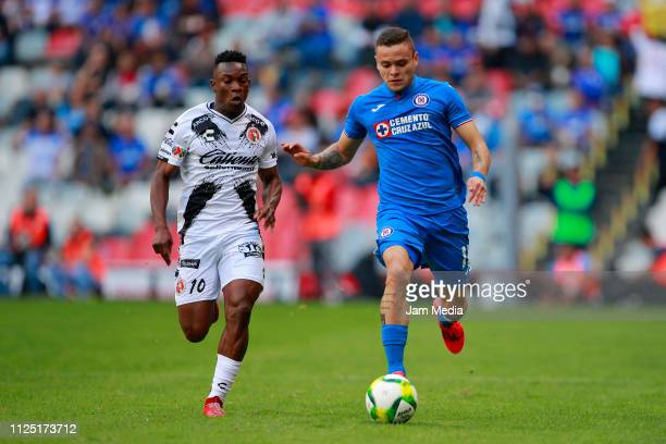 Fabian Castillo of Tijuana fights for the ball with Jonathan Rodriguez of Cruz Azul during the 4th round match between Cruz Azul and Tijuana as part...