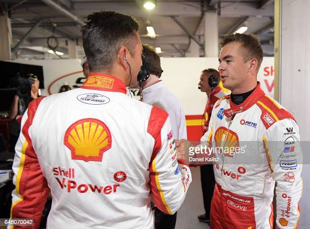 Fabian Coulthard driver of the Shell VPower Racing Team Ford Falcon FGX congratulates his team mate Scott McLaughlin driver of the Shell VPower...