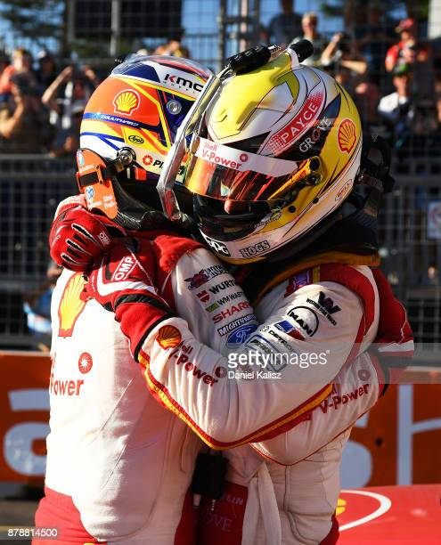 Fabian Coulthard driver of the Shell VPower Racing Team Ford Falcon FGX congratulates Scott McLaughlin driver of the Shell VPower Racing Team Ford...