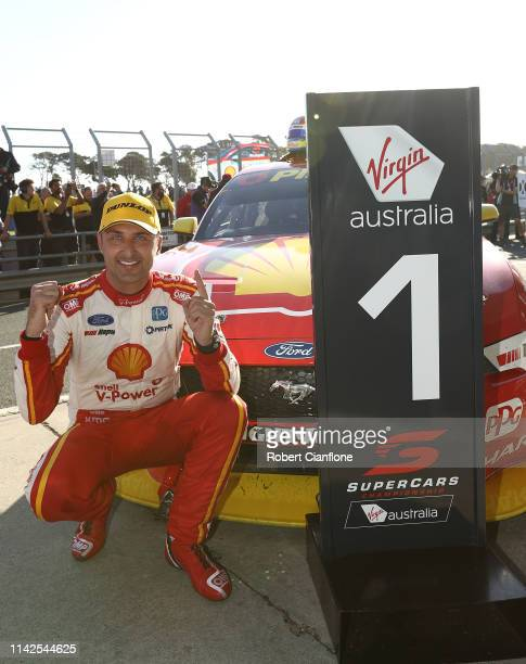 Fabian Coulthard driver of the Shell V-Power Racing Team Ford Mustang celebrates after he won race 10 during the Phillip Island 500 as part of the...