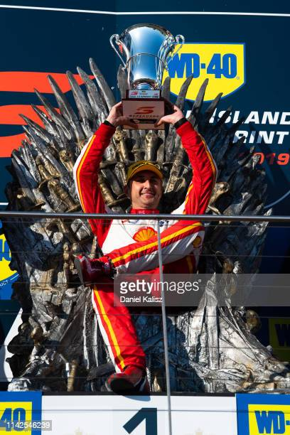 Fabian Coulthard driver of the Shell V-Power Racing Team Ford Mustang celebrates on the podium during the Phillip Island 500 as part of the Supercars...