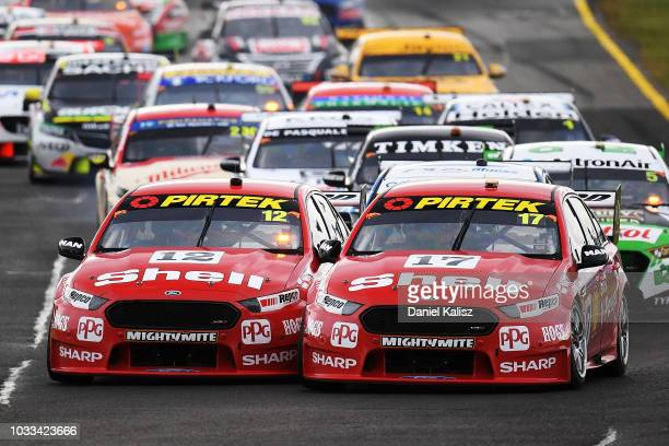Fabian Coulthard drives the Shell VPower Racing Team Ford Falcon FGX and Scott McLaughlin drives the Shell VPower Racing Team Ford Falcon FGX battle...