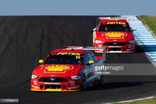 Fabian Coulthard drives the Shell V-Power Racing Team Ford Mustang leads Scott McLaughlin drives the Shell V-Power Racing Team Ford Mustang during...