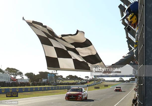 Fabian Coulthard driving the Shell V-Power Racing Team Ford Mustang crosses the line to win race ten during the Phillip Island 500 as part of the...