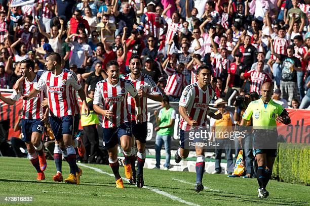 Fabian de la Mora of Chivas celebrates after scoring the first goal of his team during a quarterfinal second leg match between Atlas and Chivas as...