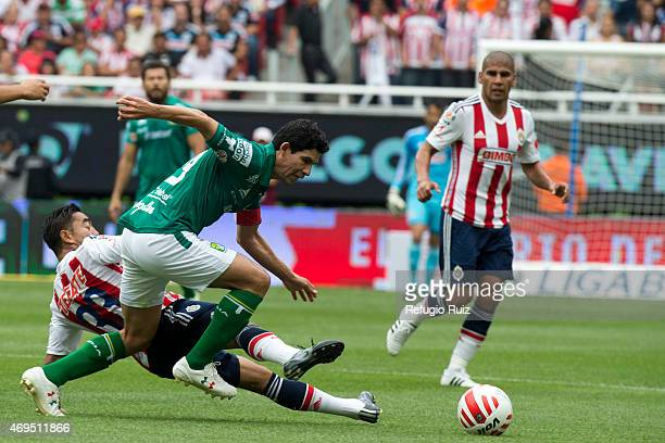 Fabian de la Mora of Chivas fights for the ball with Jonny Magallon of Leon during a match between Chivas and Leon as part of 13th round of Clausura...