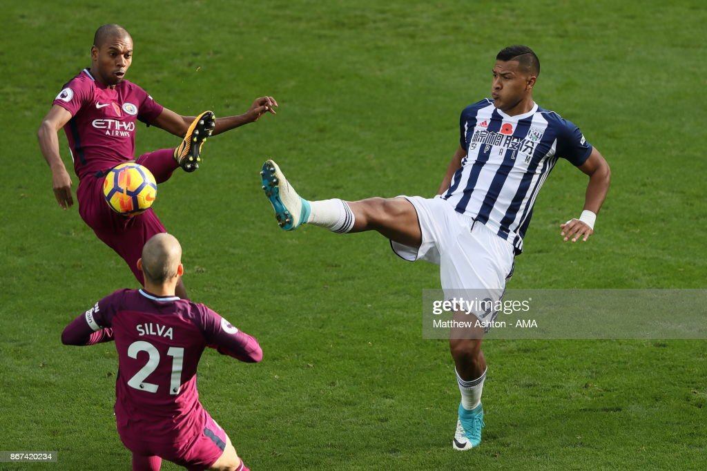 Fabian Delph and David Silva of Manchester City try and stop Salomon Rondon of West Bromwich Albion during the Premier League match between West Bromwich Albion and Manchester City at The Hawthorns on October 28, 2017 in West Bromwich, England.