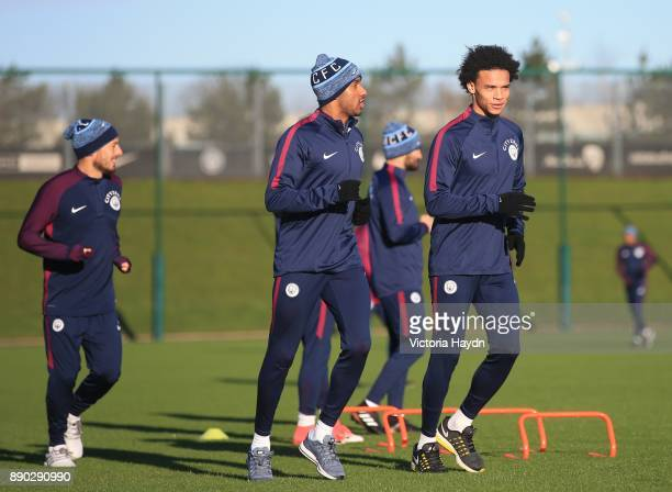 Fabian Delph and Leroy Sane lead the squad during training at Manchester City Football Academy on December 11 2017 in Manchester England