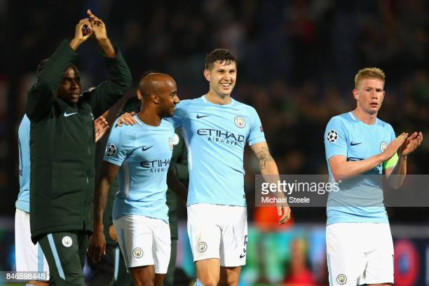 Fabian Delph John Stones and Kevin De Bruyne of Manchester City celebrate victory after the UEFA Champions League group F match between Feyenoord and...