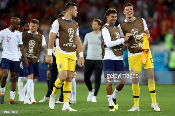 Fabian Delph Kieran Trippier Jack Butland Dele Alli and Nick Pope of England walk off the pitch following the 2018 FIFA World Cup Russia group G...