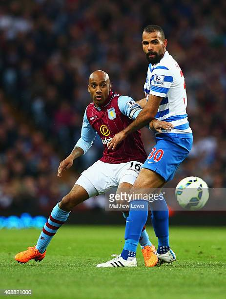 Fabian Delph of Aston Villa and Sandro of QPR watch the ball during the Barclays Premier League match between Aston Villa and Queens Park Rangers at...