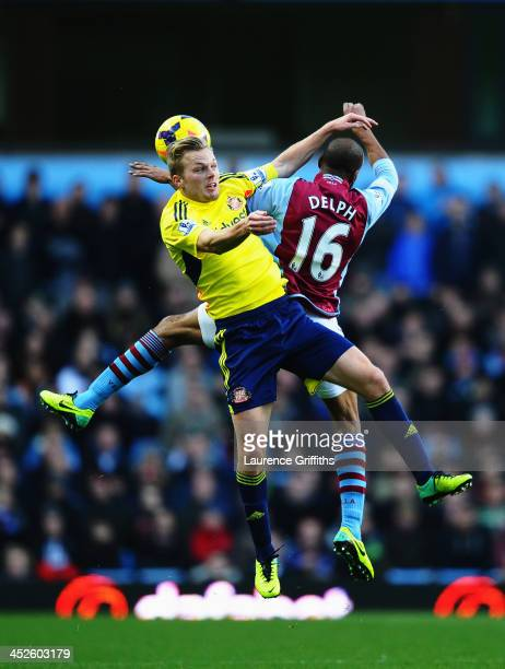 Fabian Delph of Aston Villa and Sebastian Larsson of Sunderland challenge for the ball during the Barclays Premier League match between Aston Villa...